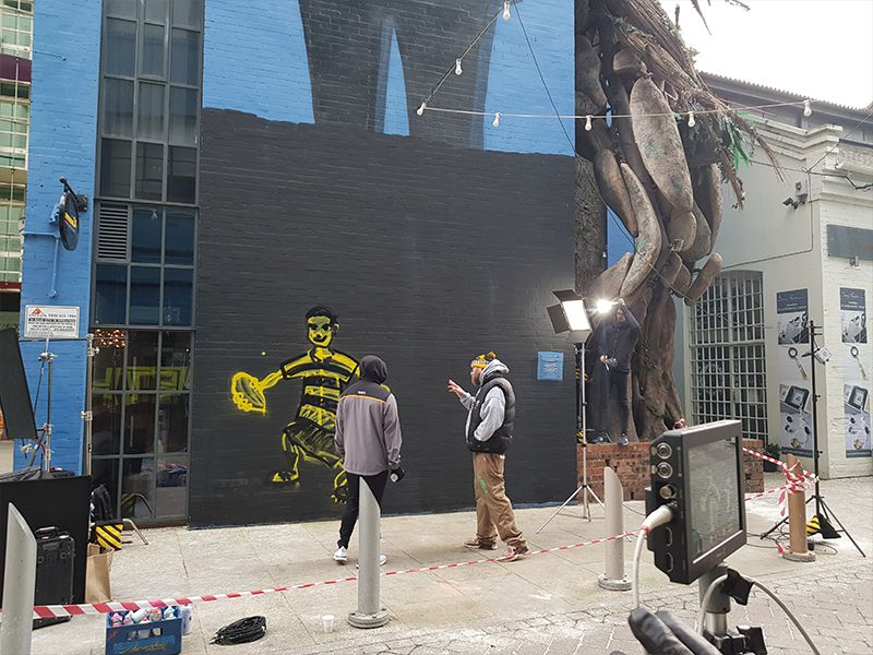 Lima and Panda spray the walls of the Custard Factory, whilst being filmed by video content agency Tinker Taylor.